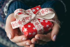 Close up shot of female hands holding a small gift royalty free stock photo