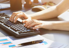 Close-up shot of a female learner typing the keyboard Stock Photo