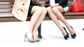 Close up shot of female legs on the bench stock footage