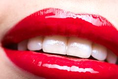 Close up shot of female red lips Royalty Free Stock Photography