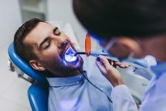 Dentist making dental procedure stock photo