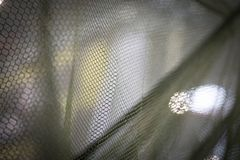 Close up shot of a fishing net. Color close up shot of a fishing net royalty free stock photo
