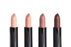 Close-up shot of four lipsticks in trendy colors Royalty Free Stock Photography