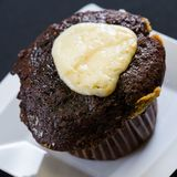 Close up shot of fresh bran muffin with icing. Close up shot of fresh bran muffin ready to be eaten stock photography
