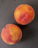 Close up shot of a fresh peach isolated Stock Photography