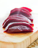 Close up shot of freshly boiled red beat on a wooden board Stock Photography