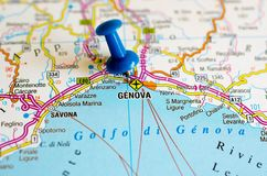 Genoa on map. Close up shot of Genoa or Genova on map with blue push pin Stock Photos