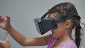 Close-up shot of a girl teen in headphones getting experience in using vr-headset. Augmented reality device creating. Close-up shot of girl teen in headphones stock video footage