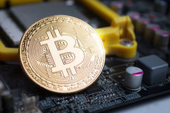 Close up shot gold Bitcoin on computer print circuit board shall Royalty Free Stock Images