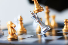 Close up shot golden chess to defeat killing silver king chess o. N white and black chess board for business challenge competition winner and loser concept stock images