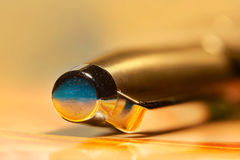 Close up shot of golden pen. Extreme close up shot of golden pen stock images