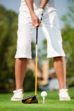Close up shot of golfer ready to tee off Stock Photo