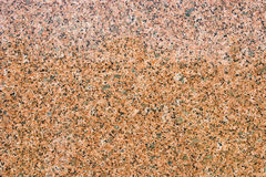 Close up shot of a granite texture. Granite texture, with black, pink, grey and red colors, can be used as a background Stock Image