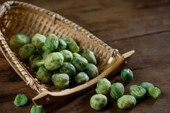 close up shot of green pea on wood background studio shot Stock Photo