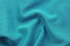 Close up shot of green textured football jersey Royalty Free Stock Photography