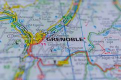 Grenoble on map. Close up shot of Grenoble or Grenoblo on map, is a city in southeastern France, at the foot of the French Alps where the river Drac joins the Is Stock Photo