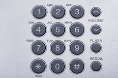 Close up shot of grey phone keypad Toned image. Close up shot of grey phone keypad Wired desktop telephone Toned image stock photo