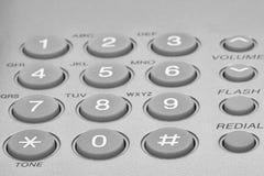 Close up shot of grey phone keypad. Wired desktop telephone stock image