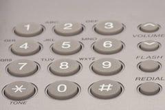 Close up shot of grey phone keypad. Wired desktop telephone stock photography