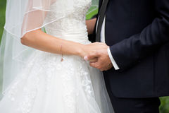 Close up shot of groom and bride. Holding hands and huging Royalty Free Stock Images