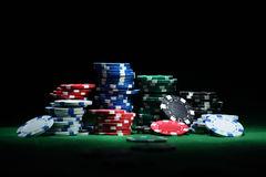 Close up shot of group poker chips on green table Royalty Free Stock Photos