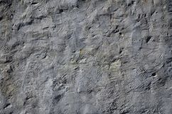 Close up shot of grunge brown clay wall on a old house. The mixture of some other object such as wood and ston. E stock image