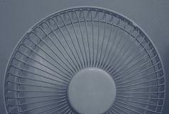 Close up shot of half of a portable fan in working mode royalty free stock photos