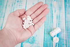 Close-up shot of a hand holding several capsuls pills. Close-up shot of a hand holding several pills Royalty Free Stock Photography