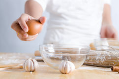 Close up shot hand of woman holding egg for braking shell with g Stock Image