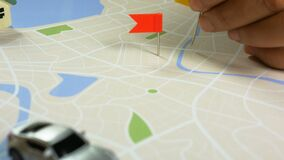 Close up shot hand of woman pinning color pin at the map metaphor planning for transport and travel. L stock footage