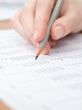 Close-up shot of hand writing in the document Stock Photo