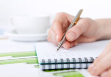 Close up shot of hand writing in the notebook stock image