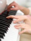 Close up shot of hands playing piano Stock Images