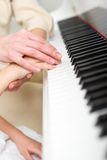 Close-up shot of hands playing piano Stock Images
