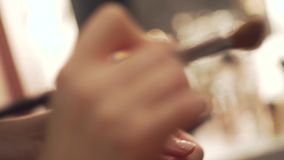 Make up artist. Close up shot on the hands of professional make up artist stock footage
