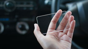 Close up shot hands of woman using blank clear glass same like smart phone in the car for futuristic cyber technology transport co. Ncept stock video