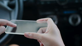 Close up shot hands of woman using blank clear glass same like smart phone in the car for futuristic cyber technology transport co stock video footage