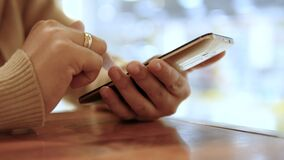 Close up shot hands of woman using smart phone select focus shallow depth of field.  stock video