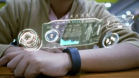 Close up shot hands of woman using smart watch with HUD user interface for cyber futuristic application and technology. Concept stock video footage