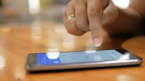 Close up shot hands of woman using smartphone select focus shallow depth of field.  stock footage