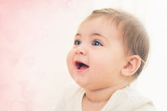 Close up shot of happy smiling baby girl with blue eyes. Soft fo Royalty Free Stock Images