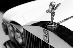 Close up shot of the hood ornament `Spirit of Ecstasy` and the logo of a vintage Rolls Royce car. Selective focus on the hood or. Heraklion, Crete / Greece stock images
