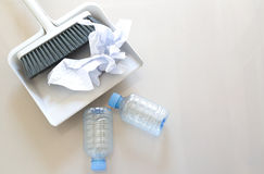 A close up shot of household floor cleaning items and paper ,bot Stock Photo