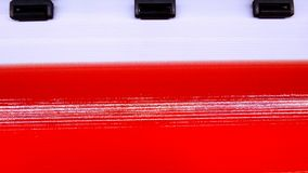 Close up shot of ink detail. On large scale Inkjet system. Jetting ink on media as PVC with red color Royalty Free Stock Images