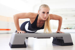 Close-up shot of instructor performing exercising workout Royalty Free Stock Photography