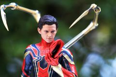 Close up shot of Iron Spiderman superheros figure in action royalty free stock images