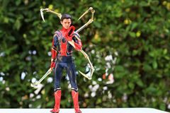 Close up shot of Iron Spiderman superheros figure in action stock photo