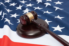 Close up shot of a judge gavel over United States flag. Close up shot of a judge gavel over United States of America flag Royalty Free Stock Image