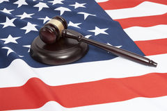 Close up shot of a judge gavel over US flag Royalty Free Stock Image