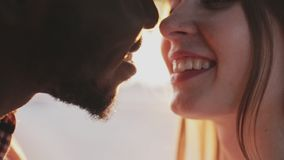 Close-up shot of a kiss on a sunset background stock footage